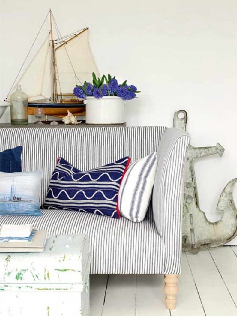 Navy and white ticking sofa with nautical elements