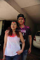 Govinda celeting Holi with His family wife daughter 001.JPG