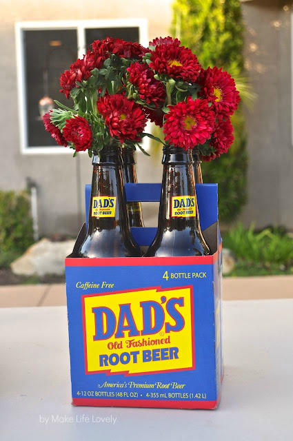 Dad's root beer bottles with red flowers inside