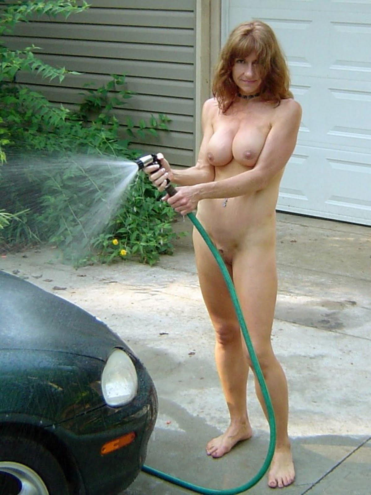 Hot naked women using a dildo