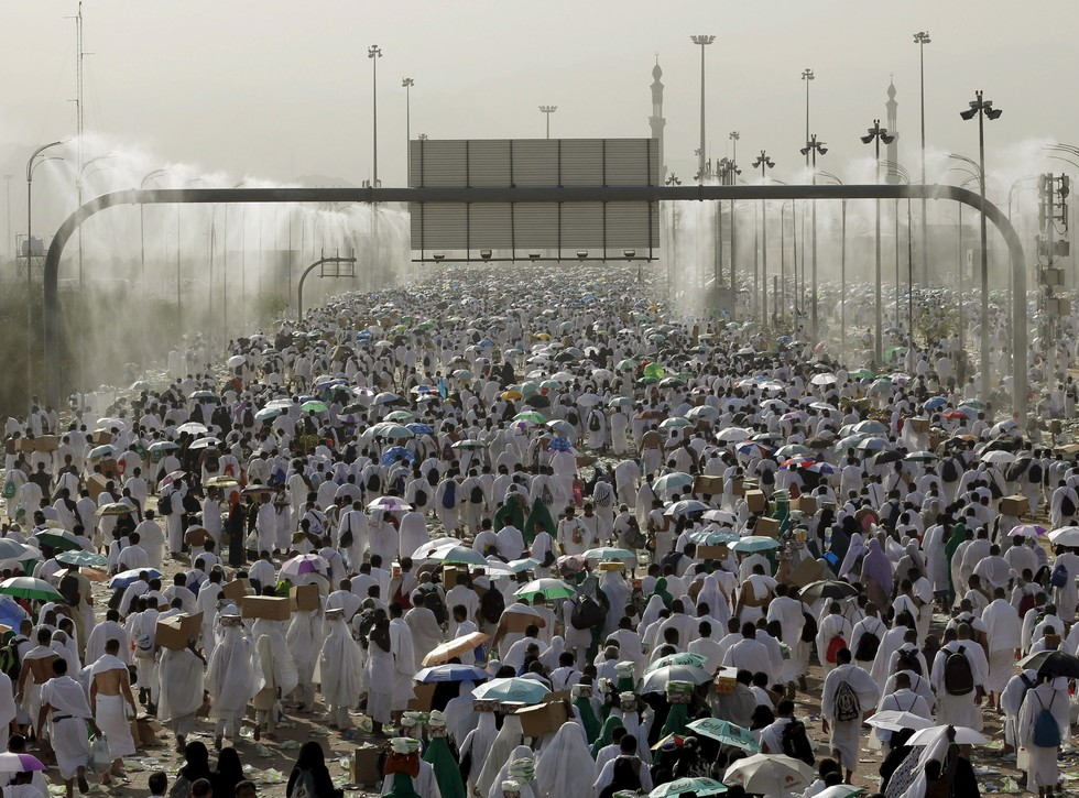 70 Of The Most Touching Photos Taken In 2015 - Two million Muslim pilgrims walk on roads in Mecca during the annual Hajj. At least 717 died following a stampede during the stoning of the devil.