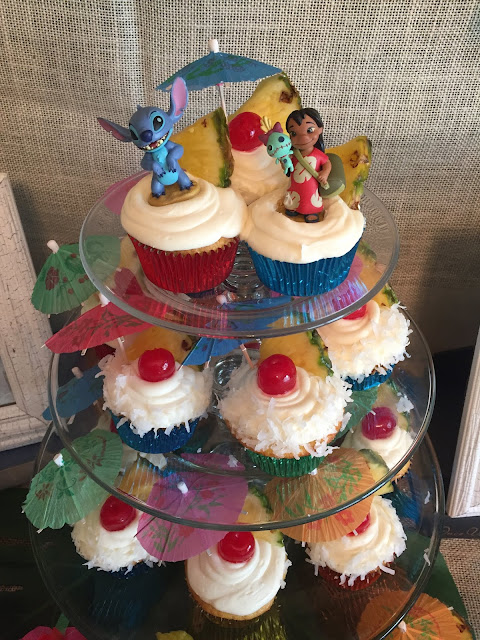 How to plan the perfect party without losing your mind. Birthday parties, bridal showers, baby showers, and other events. Lilo and Stitch luau birthday party. Table decorations and food, cupcakes