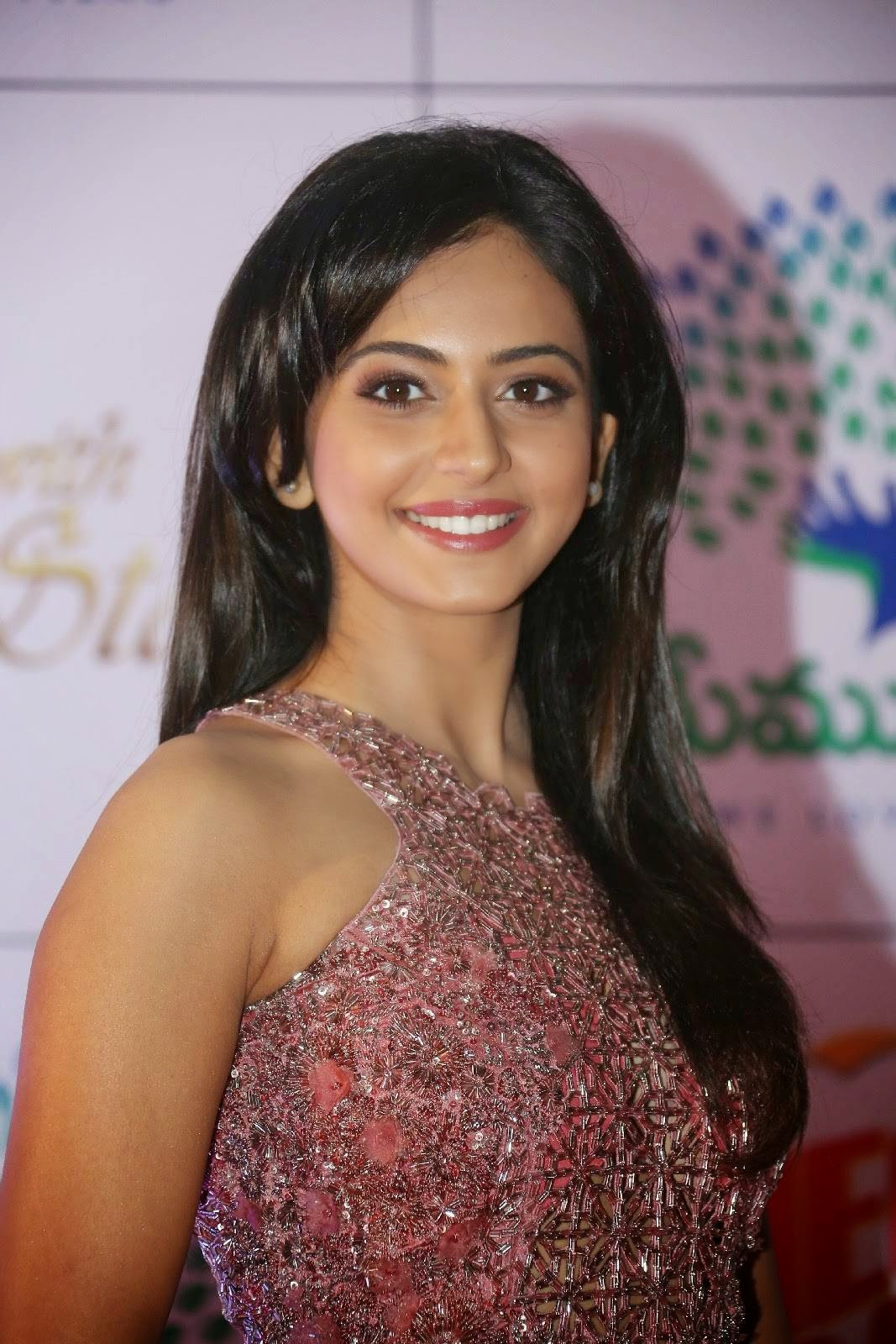 South Indian Hot Girl Rakul Preet Singh Stills At Memu Saitam In Maroon Dress