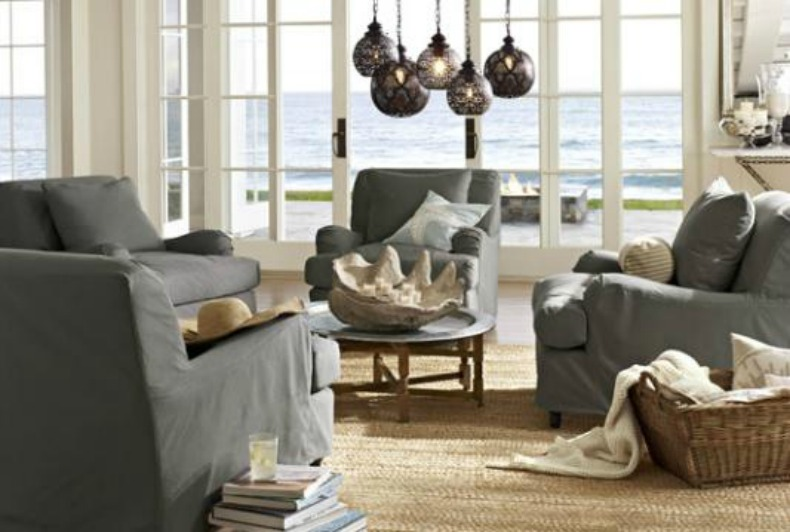 gray and natural coastal living room with slipcovered sofa and chairs