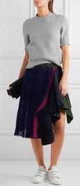 Black Sacai midi skirt, with grey sweater on Netaporter.com