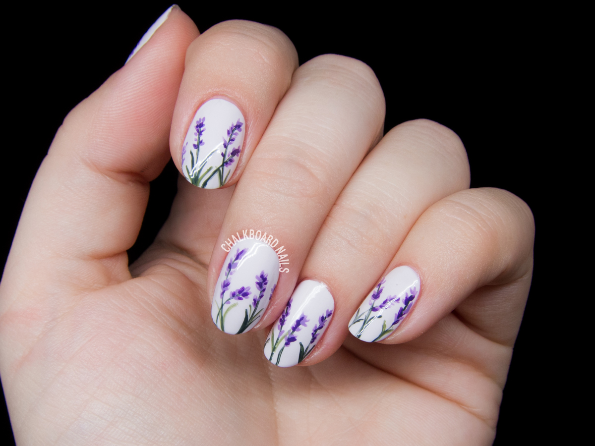 Delicate lavender blossoms by @chalkboardnails