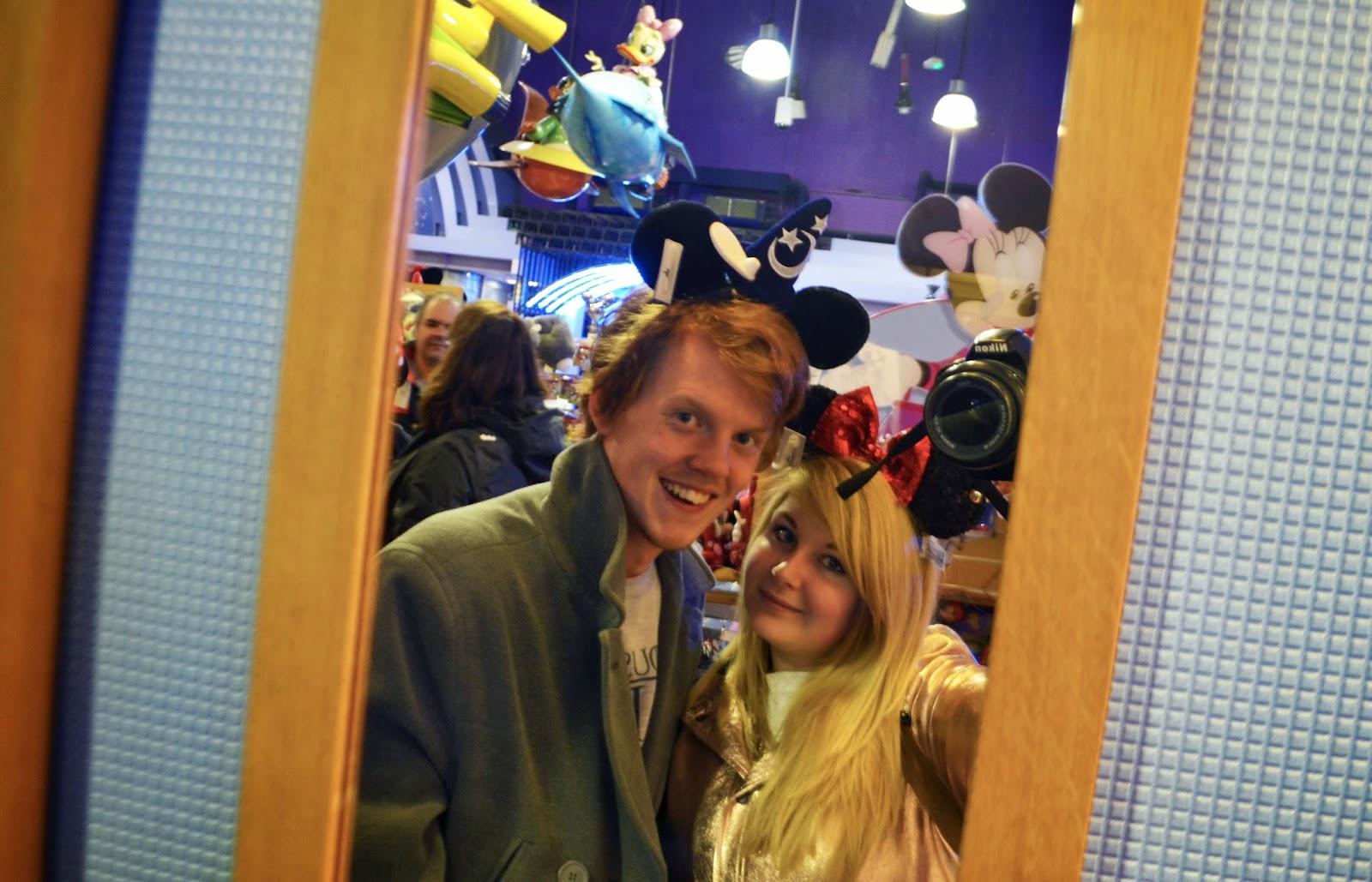 a mirror selfie taken in a shop in the Disney Village. We are both wearing Disney mouse ears