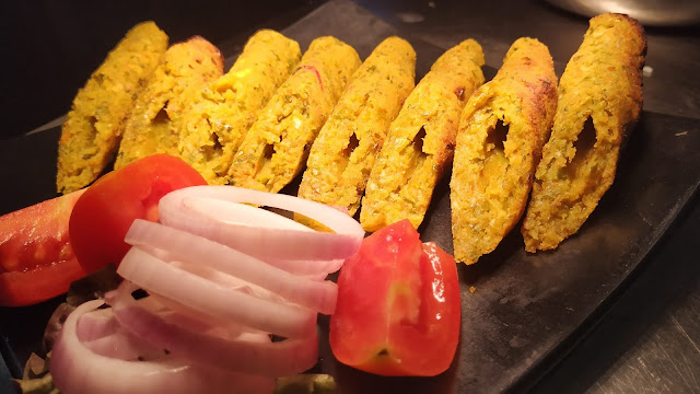 Vegetable Seekh Kebab pieces with ring onion and tomato Food recipe