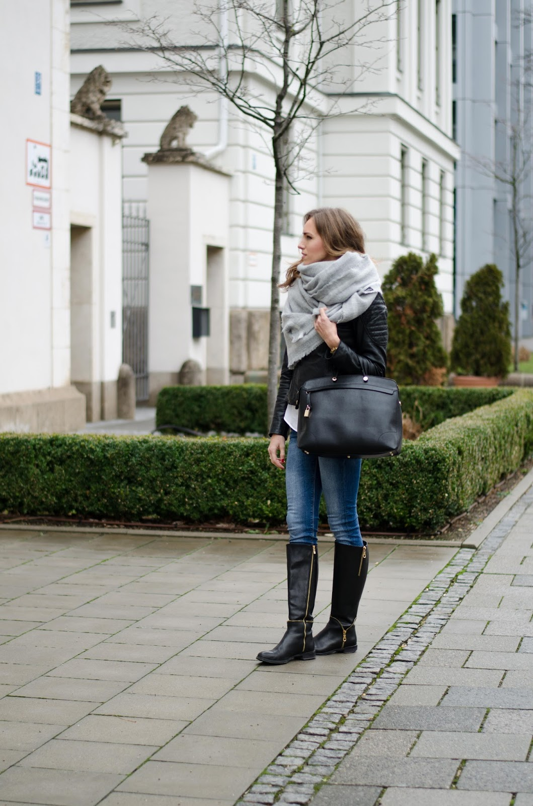 kristjaana mere casual winter outfit with knee boots and leather jacket