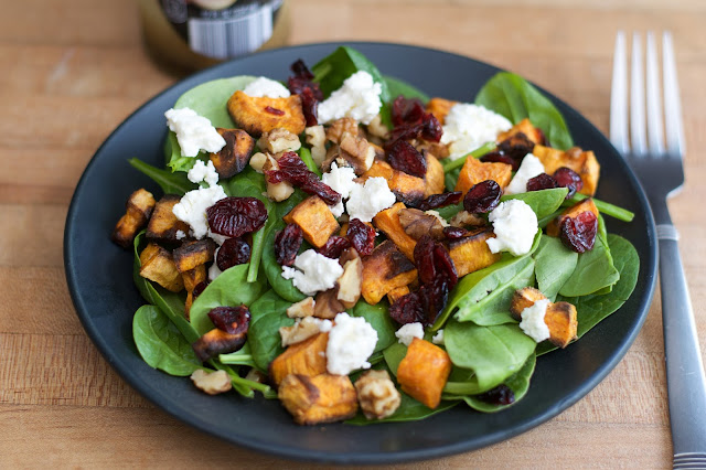 The finished Roasted Sweet Potato Spinach and Feta Salad on a black plate