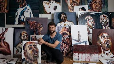 Ben Quilty with Myuran Sukumaran's paintings.  Photo: Daniel Boud