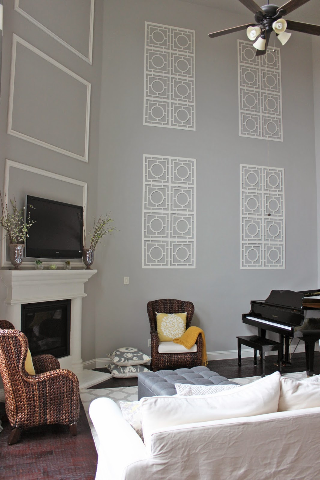 A little of this a little of that decorating a two story - How to decorate tall walls ...