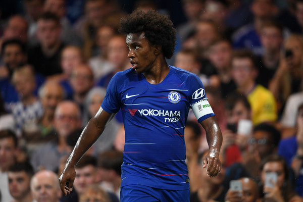 Willian of Chelsea looks on during the pre-season friendly match between Chelsea and Lyon at Stamford Bridge on August 7, 2018 in London, England.