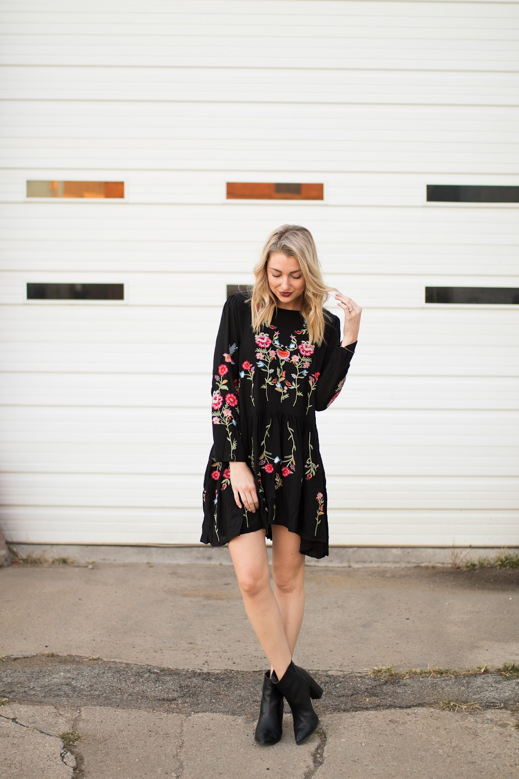 Black swing dress with floral embroidery