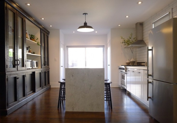 Beautiful white and rustic modern farmhouse style kitchen with black and white decor on Hello Lovely Studio
