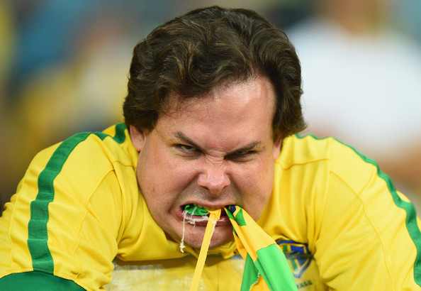 An emotional Brazil fan reacts after being defeated by Germany 7-1 during the 2014 FIFA World Cup Brazil Semi Final match between Brazil and Germany at Estadio Mineirao on July 8, 2014 in Belo Horizonte, Brazil