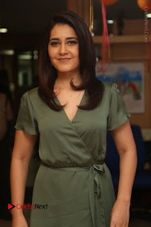 Actress Raashi Khanna Stills in Green Short Dress at Mirchi 95 Suno Aur Mercedes Jeeto Contest  0003.JPG