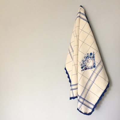 Embroidered kitchen towel with crocheted border