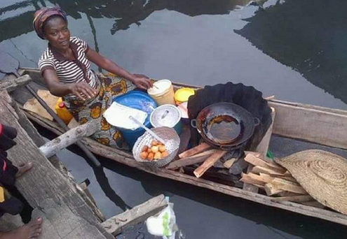 woman selling akara on canoe
