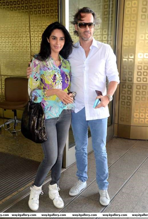 Our shutterbug caught Bollywood actress Mallika Sherawat and her French boyfriend Cyrille Auxenfans at Mumbai airport