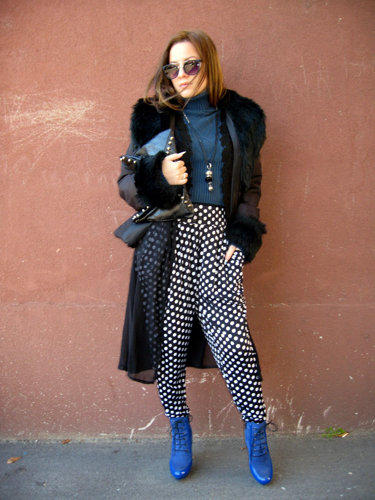outfit, blue turtleneck sweater, baggy pants with polka dots, black crochet lace kimono, black faux fur jacket, black studded clutch, blue boots
