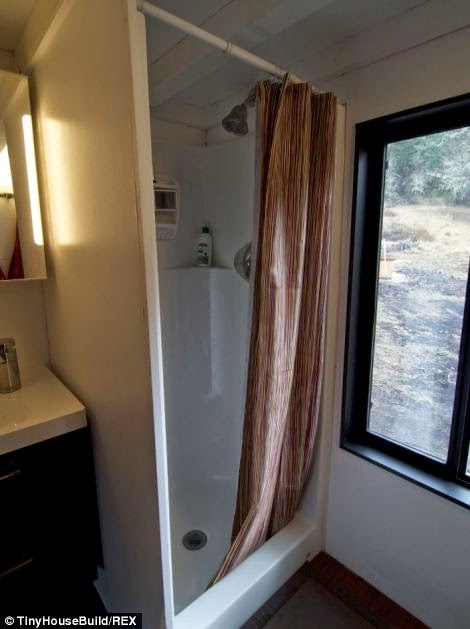 The tiny house has a shower and toilet. - This Couple Got Out Of The Rat Race. And Built This Tiny Home For $33K.