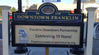 The sign acknowledges the work of the Downtown Partnership to foster the renovations downtown