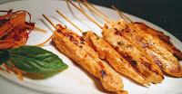Homestyle chicken satay in garnished plate chicken satay recipe