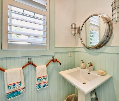 nautical bathroom with porthole mirror