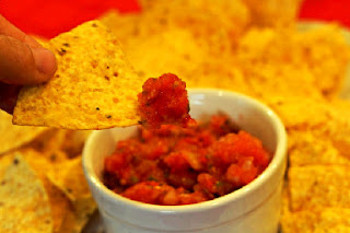 chip dipped into fresh tomato salsa