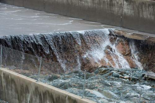Slideshow: Water flowing over emergency spillway at Lake Oroville