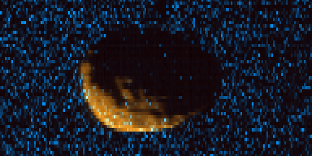 Phobos as observed by MAVEN's Imaging Ultraviolet Spectrograph. Orange shows mid-ultraviolet (MUV) sunlight reflected from the surface of Phobos, exposing the moon's irregular shape and many craters. Blue shows far ultraviolet light detected at 121.6 nm, which is scattered off of hydrogen gas in the extended upper atmosphere of Mars. Phobos, observed here at a range of 300km, blocks this light, eclipsing the ultraviolet sky. Credits: CU/LASP and NASA