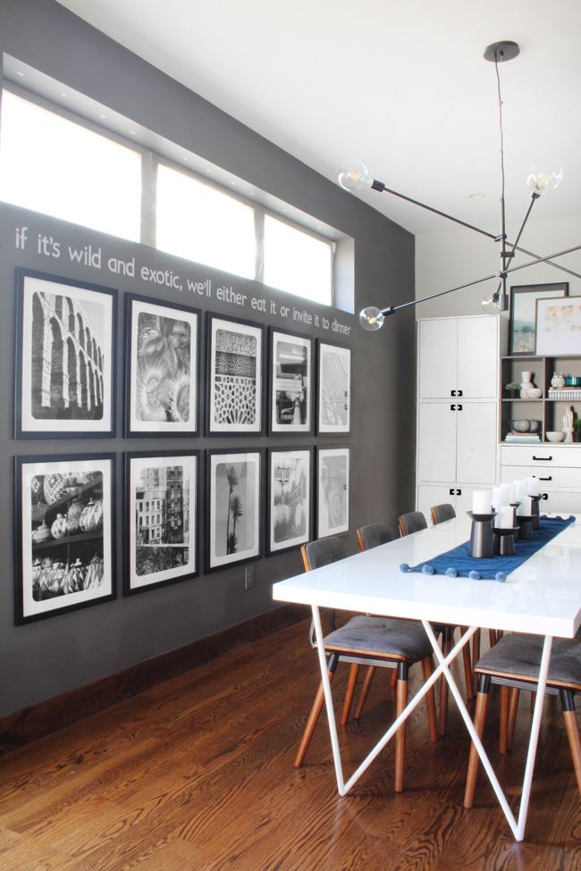 dark gray dining room walls, black and white photo gallery wall, West Elm Mobile Grand Chandelier, White Dylan Dining Table