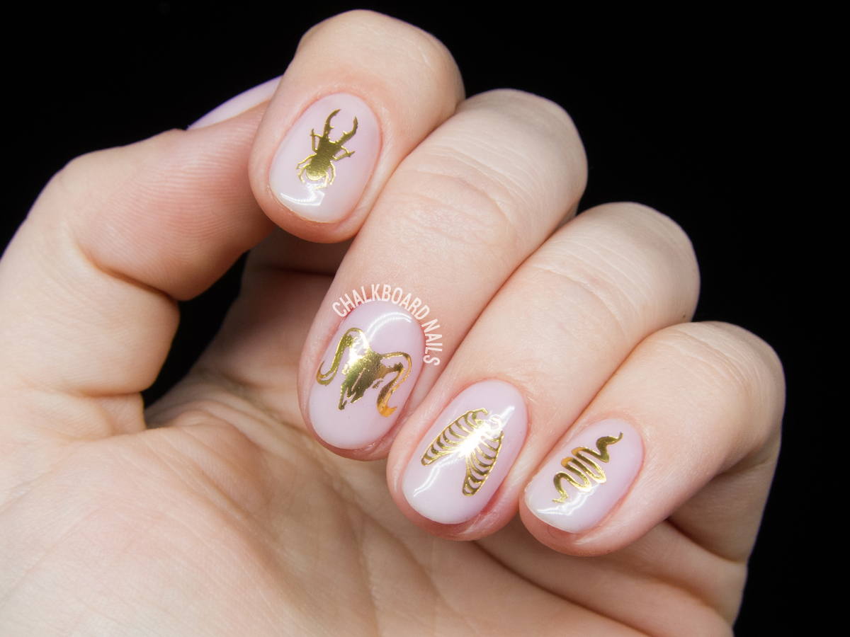 The Collector - Gel manicure with decals by @chalkboardnails