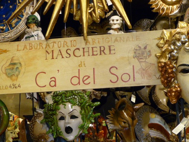At the front door of Ca del Sole, one of Venice's most famous mask shops