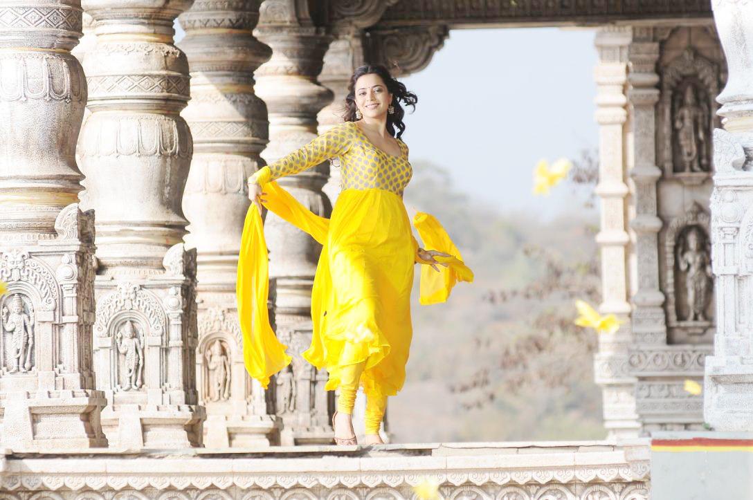 gorgeous ethnic Nisha agarwa in yellow designer suite latest stills in yellow dress