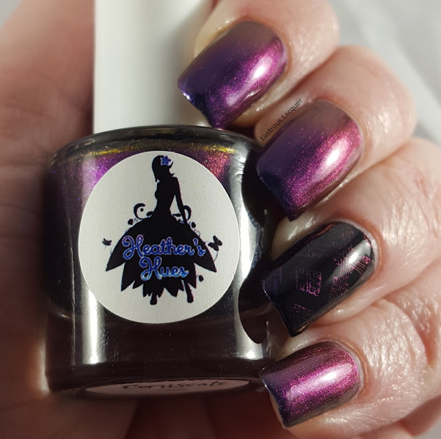 A purple to blue shifting multi-chrome nail polish with flashes of magenta and orange.