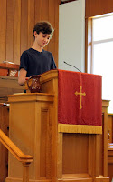 Young man preaching from CUCC's pulpit