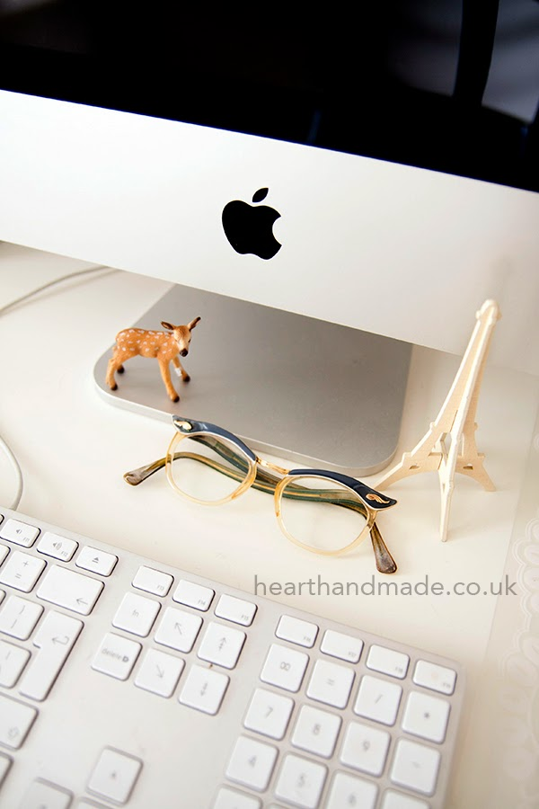 Beside the computer - a little deer, eiffel tower and retro glasses