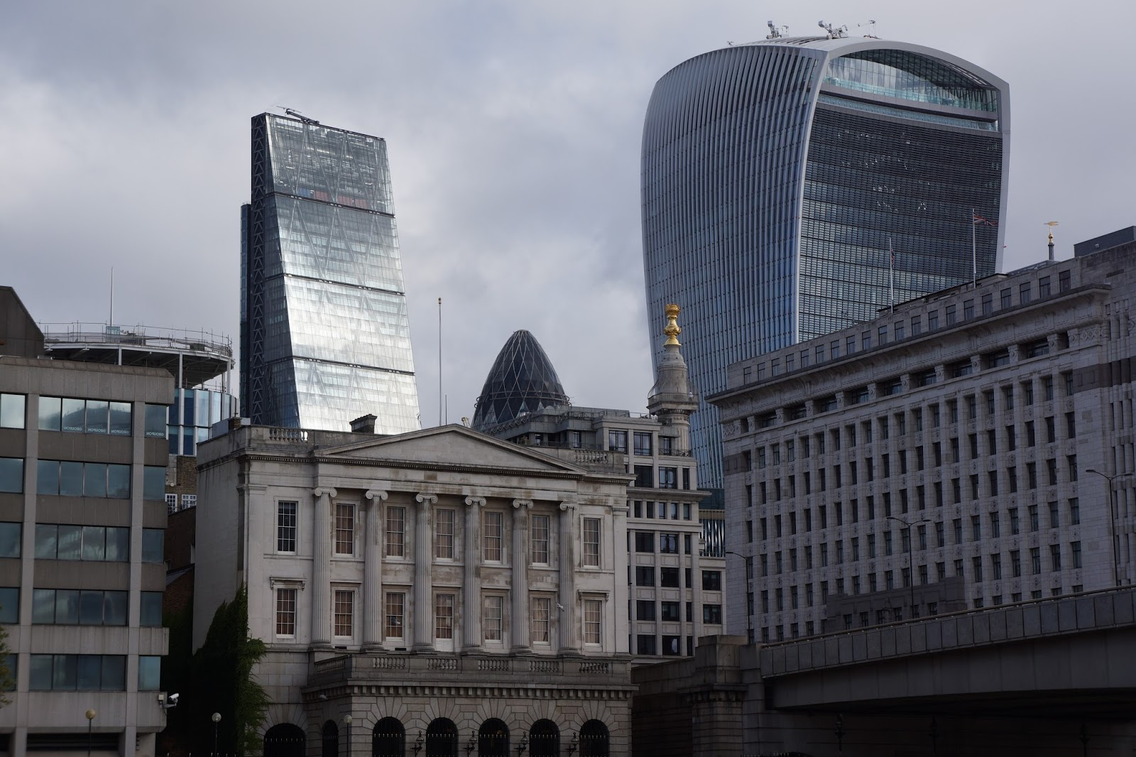 city skyscrapers seen from river thames