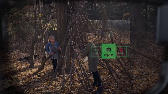 smart glass capturing photos of kids playing game on screen