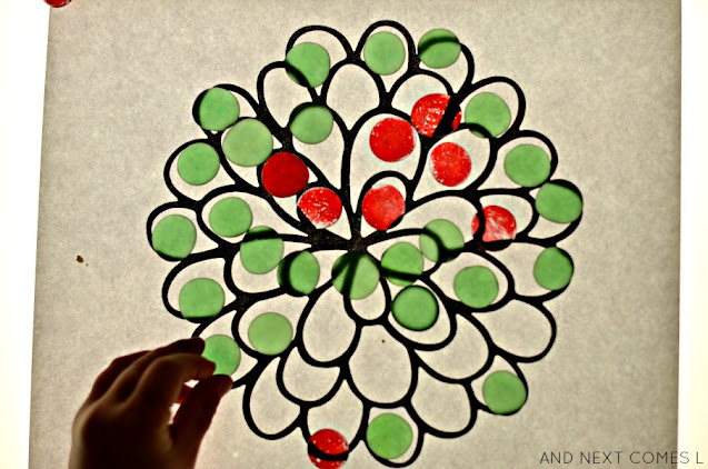 Green and red flower mandala on the light table