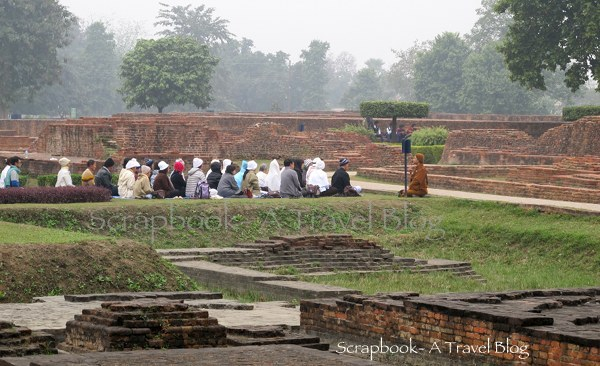 Monk addressing devotees at Mahaparinirvana temple Khushinagar Uttar Pradesh India