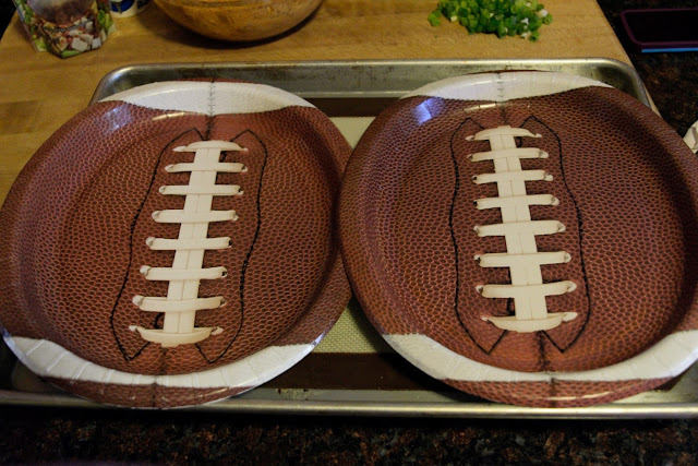 A picture of two football plates on a baking sheet.