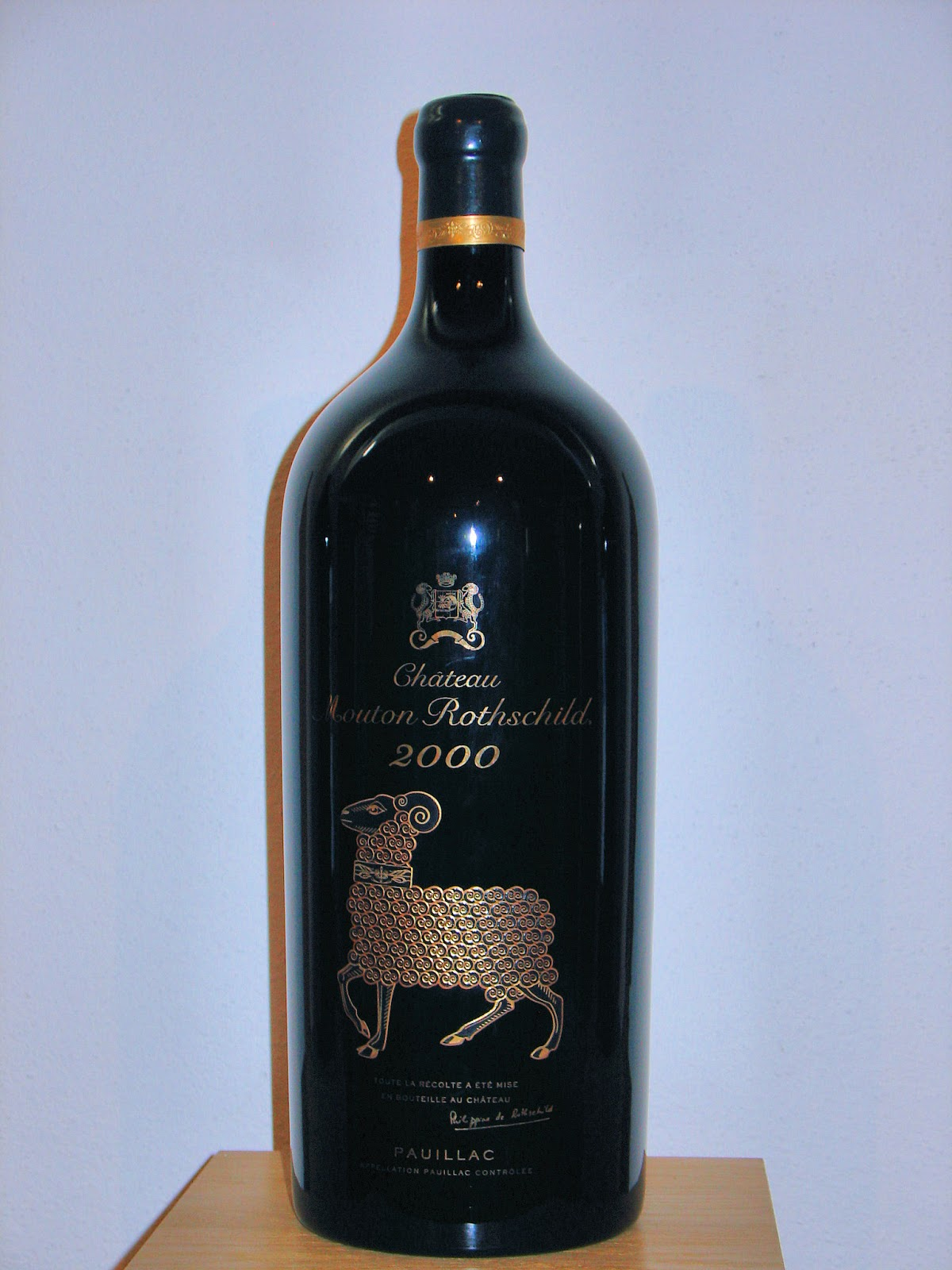 The new millennium was the only year that an artist was not commissioned to decorate the label. The design was inspired by a piece in the Chateau's Museum of Wine in Art, the 'Augsburg Ram,' a silver-gilt drinking vessel created circa 1590 by Jakob Schenauer, a German master goldsmith. A special enameling process was developed to produce the bottle's texture and luster.