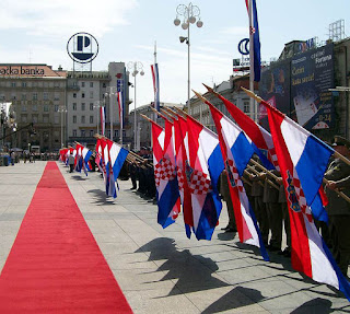 Soldiers keep the flags in greeting to Supreme Commander of Croatian Army