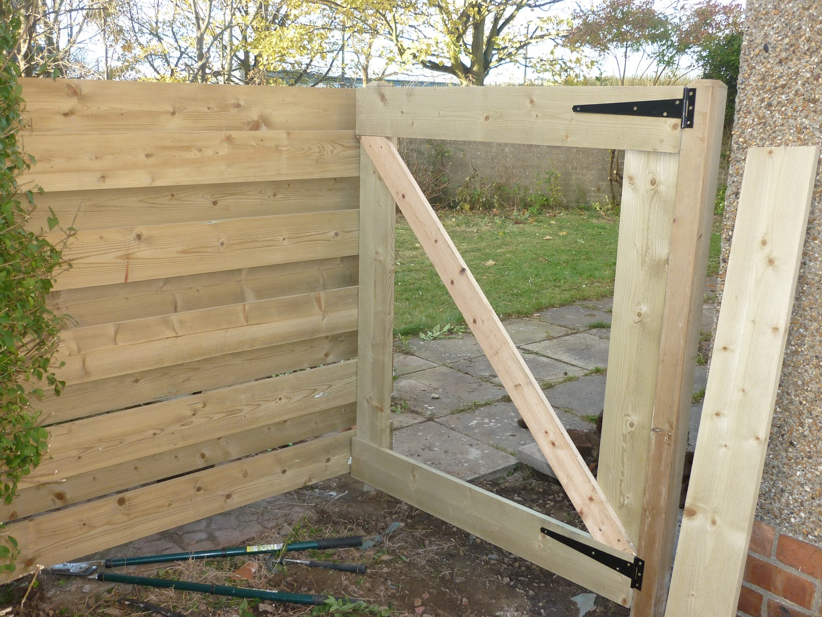 The Existing Fence And Gate Had Rotted Away Now Their Garden Was Being Used As A Thoroughfare By Local Neds
