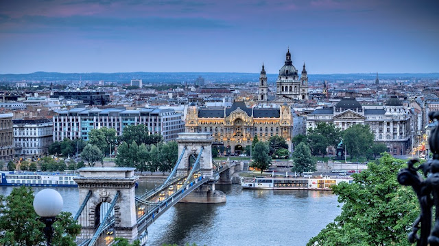 Photo of bridge and cityscape in Budapest, Hungary