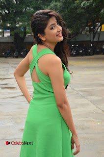Actress Poonam Kaur Pictures in Green Short Dress at Prayanam Movie Opening  0051.JPG