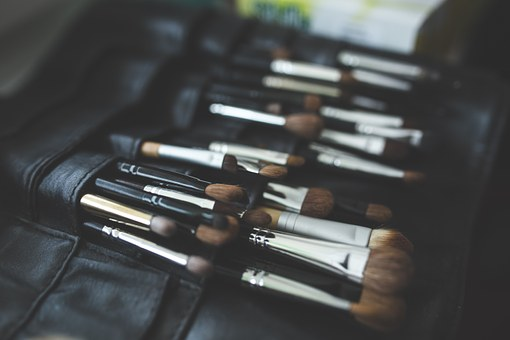 Six Most Indispensable eye brushes in opened roll of makeup brushes